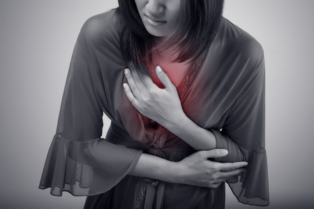 symptomatic: Woman suffering from acid reflux or heartburn