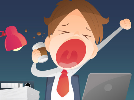 yawning: Businessman working overtime late night in office