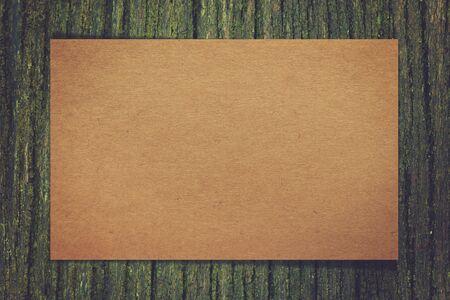 photo realism: Paper on wood background Stock Photo