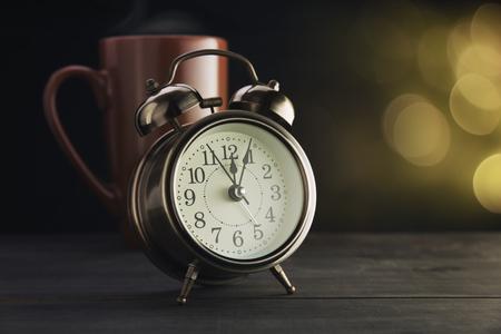 alarmclock: Bokeh background with retro alarm clock on table.