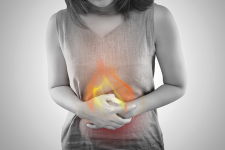 The Photo Of Fire Is On The Woman's Body. People With Stomach Ache Problem Concept. Female Anatomy
