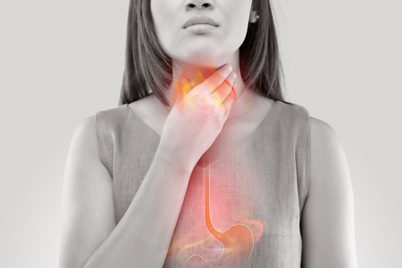 Woman Suffering From Acid Reflux Or Heartburn-Isolated On White Background