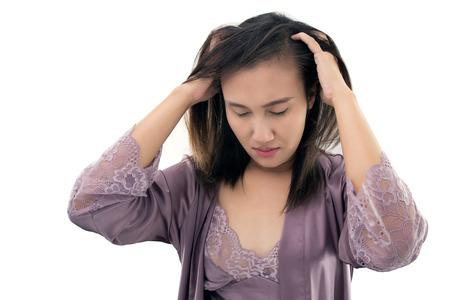 Asian women in itching scalp against gray background Concept with dandruff and hair care Archivio Fotografico