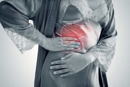 The Photo Of Liver On Womans Body Against Gray Background, Hepatitis, Concept with Healthcare And Medicine Stock Photo