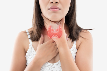 The photo of thyroid is on the human body, Women thyroid gland control. Sore throat of a people against gray background.