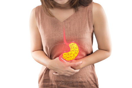 Woman suffering from indigestion or gastric isolated on white background Foto de archivo