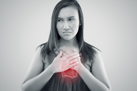The photo of heart is on the womans body, Severe heartache, Having heart attack or Painful cramps, Angina Pectoris, Heart failure from coronary artery disease Stok Fotoğraf