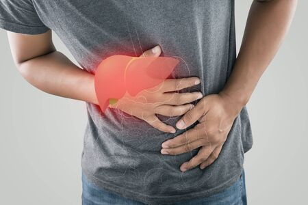 The photo of the large intestine is on the people body against gray background, Man with stomach ache problem concept, Male anatomy Stock Photo