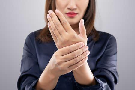 Acute pain in a women wrist. Women suffering from hand pain.
