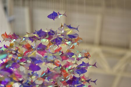 The fish is made of reflective paper and the beautiful bokeh is used as background image.