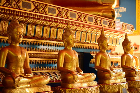 The golden Buddha image. Reverence in Buddhist sutras At Wat Luang Pothit, Thailand