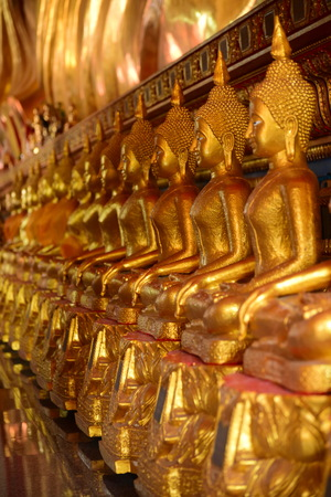 The golden Buddha image. Reverence in Buddhist sutras At Wat Stock Photo
