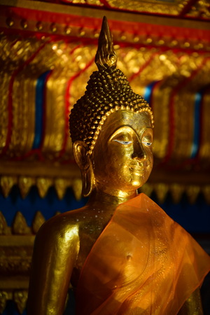 Beautiful golden Buddha In the temple of Thailand. Travel and worship of tourists and Thai people.