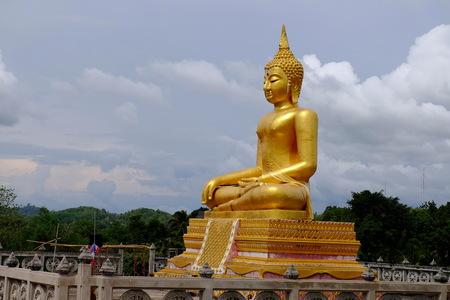 Golden Buddha Burmese art Thai style mixed Thai art. The border of Thailand, Myanmar, Sangklaburi, Kanchanaburi, Thailand.
