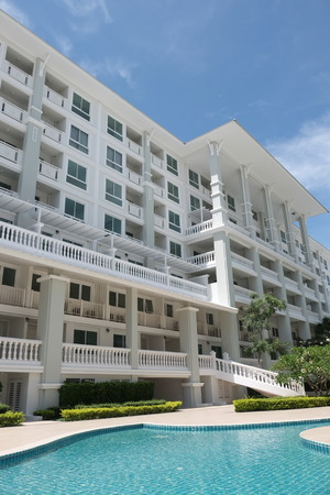 Modern Building On a sunny day.Modern white danish residential condominium building near Chaaum thailand. Stock Photo