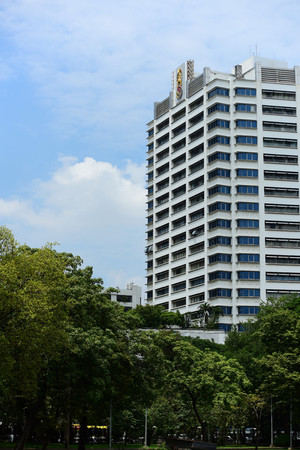 Visitors to downtown and high rise buildings in Bangkok from the park . Stock Photo
