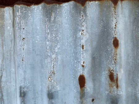 Silver zinc background that rust slightly brown as natural wallpaper Banco de Imagens