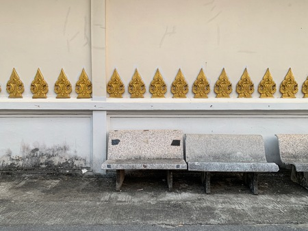 White marble chair Placed beside the temple wall