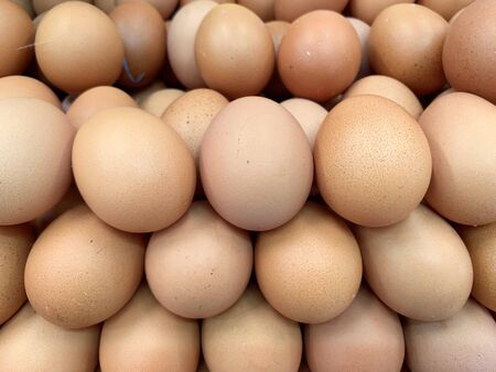 Closed up image of many fresh hen or chicken eggs laying together, organic eggs