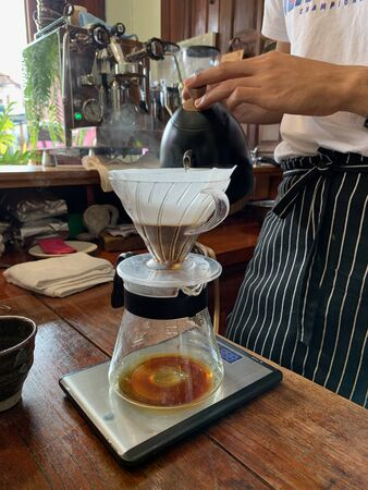 Barista currently dripping fresh coffee