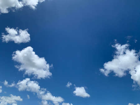 white clouds in the blue sky background