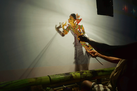Blurred of actor showing shadow play folk art of the southern, thailand.