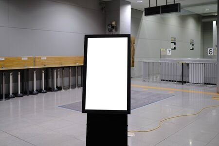 Blank billboard mockup near to escalator in an mall, shopping center, airport terminal, office building or subway station.