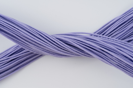 Rope, purple rubber rope. Twisted rope beautifully on a white background.
