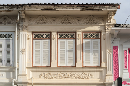 Bright vintage Sino-Portuguese Architecture of many the buildings in Phuket town. These old buildings have been constructed more than hundred years and this architectural style is European mixed with Chinese modern. Phuket, Thailand. Ancient window.