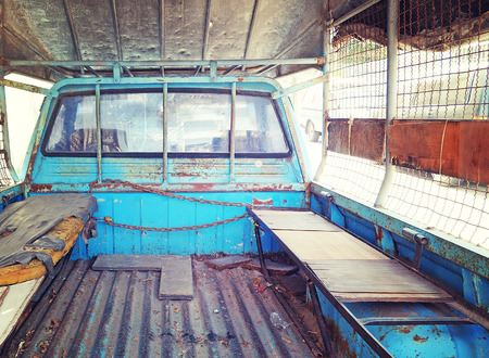 mattress: Old mattress place behind back of blue pickup truck in vintage retro style color