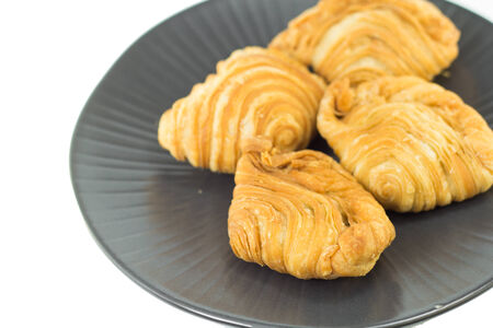curry puffs in black plate isolated photo