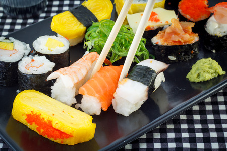 sushi with chopsticks photo