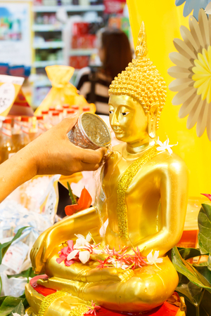 water pouring to Buddha statue in Songkran festival tradition of thailand Zdjęcie Seryjne - 27302783