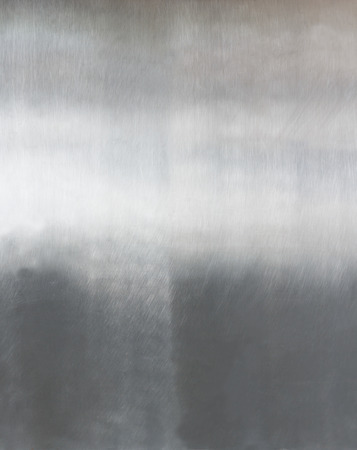 Metal background or texture of brushed steel plate photo