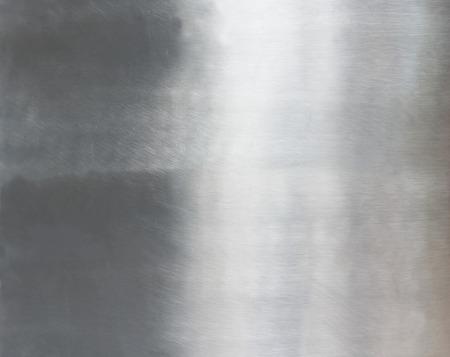 金属の背景またはブラシをかけられた鋼鉄板のテクスチャ 写真素材