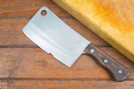 cleaver: cutting board and old meat cleaver on wooden background