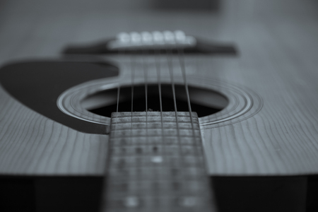 Guitar Strings, close up. Acoustic guitar. Black and white , shallow focus