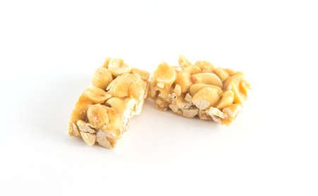 brittle: Peanut brittle isolated on white background