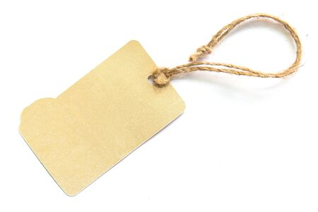 blank tag: Blank brown cardboard price tag or label on white background.