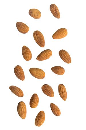 Falling almonds on white background. Zdjęcie Seryjne