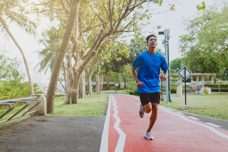 Athletic man running in the public park , Healthy lifestyle.