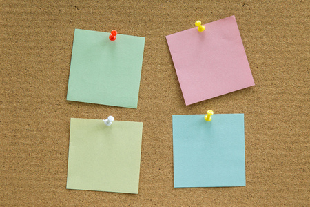pin board: Cork board with blank paper notes for add text message. Stock Photo