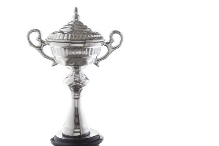 Close up of silver trophy isolated on white background. Winning awards with copy space.