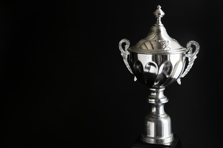 Close up of Silver trophy over black background. Winning awards with copy space for text and design. Standard-Bild