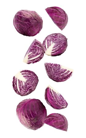 Cutted red cabbage falling isolated on white background