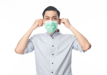 Young Asian Businessman wearing hygienic mask to prevent infection, 2019-nCoV or coronavirus. Airborne respiratory illness such as pm 2.5 fighting and flu isolated on white background.