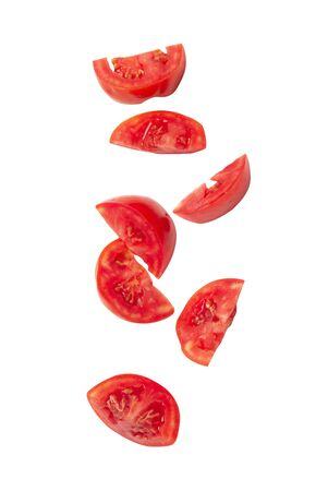 Falling tomato slice isolated on white background with clipping path.