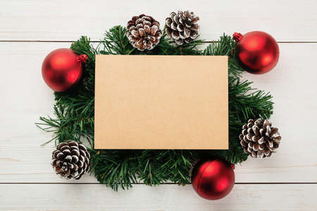 Christmas and new year with gift box wrapped with kraft brown paper and red ribbon on wooden table background top view. 版權商用圖片 - 158260687
