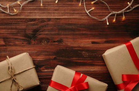 Christmas and new year with gift boxes and string light decoration on wooden table background top view with copy space. 版權商用圖片 - 158260706