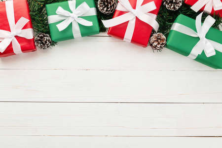 Christmas and new year with gift boxes and string light decoration on wooden table background top view with copy space. 版權商用圖片 - 158260709